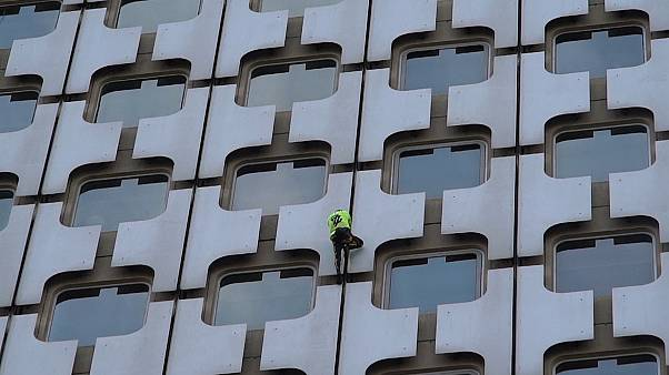 'French Spider-Man' Alain Robert scales Paris skyscraper as police watch on