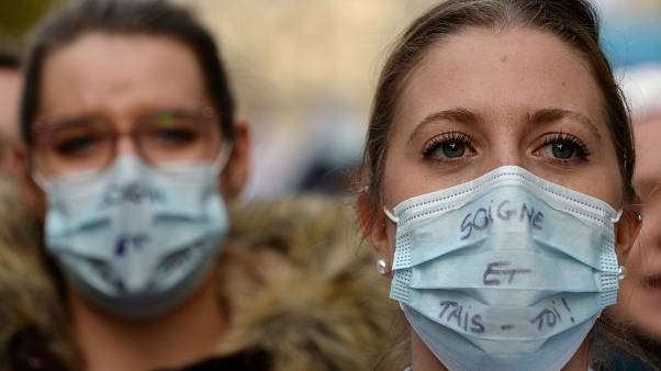 French hospitals and health workers on strike attend a demonstration in Paris