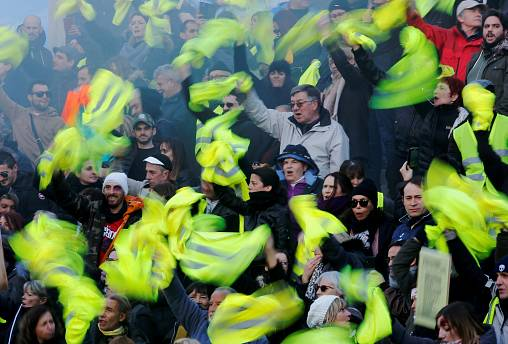 """FILE PHOTO: Protesters wearing yellow vests take part in a demonstration of the """"yellow vests"""" movement in Marseille, France February 2, 2019."""