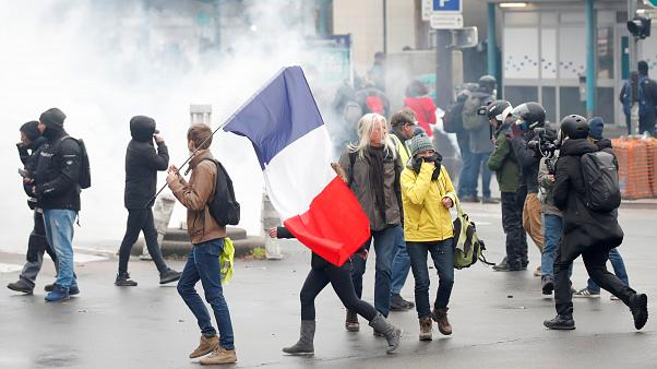 Early clashes in Paris on Saturday's one-year anniversary of Gilets Jaunes protests