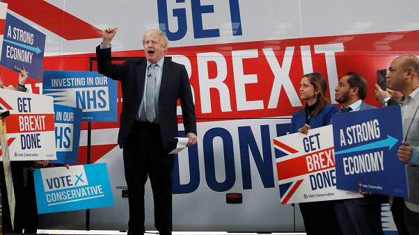 Britain's Prime Minister Boris Johnson addresses his supporters in front of the general election campaign trail bus in Manchester, Britain November 15, 2019.