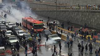 People protest against increased gas price, on a highway in Tehran, Iran November 16, 2019.