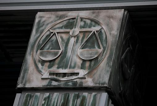 An image of scales is pictured on a pillar of the Supreme Court in Warsaw, Poland