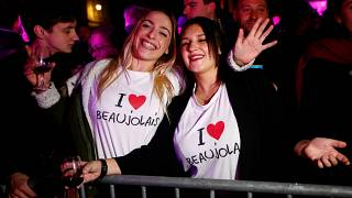 Party goers celebrate the drilling of this year's Beaujolais barrels