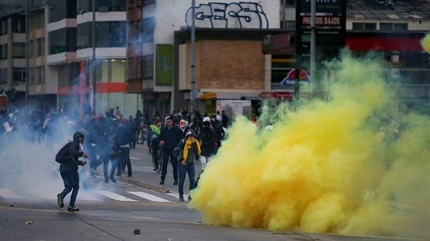 Demonstrators clash with riot police during a protest in Bogota, Colombia, November 21, 2019.