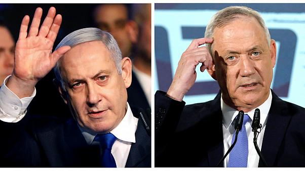 Israel opposition leader Gantz calls on PM Netanyahu to resign but supports unity government