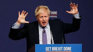 رئيس الوزراء البريطاني بوريس جونسون خلال إطلاق برنامج الحزب في مؤتمر حزب المحافظين في تلفورد قبل انتخابات ديسمبر. 24/11/2019
