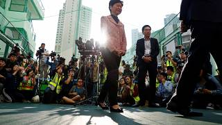 Hong Kong Chief Executive Carrie Lam leaves after speaking to the media, after casting her vote at a polling station during district council local elections in Hong Kong