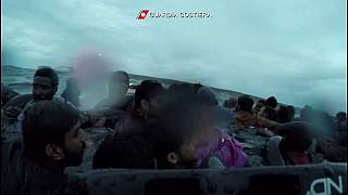 A child is rescued after a ship carrying migrants capsized off the coast of Lampedusa