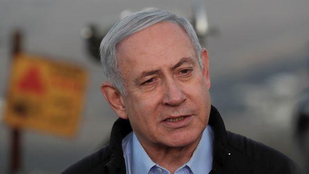 رئيس الوزراء الإسرائيلي المنتهية ولايته بنيامين نتنياهو خلال زيارة قام بها إلى مرتفعات الجولان المحتل (رويترز)