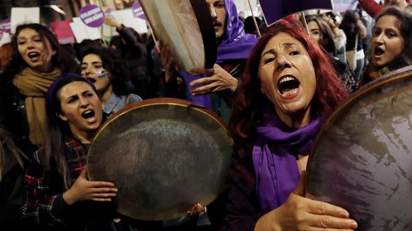 Demonstrators shout slogans during a protest against femicide and violence against women, in Istanbul