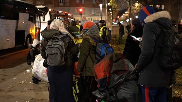 Refugees were lining at dawn to embark into buses as their campsite in northern Paris was being evacuated on Thursday, November 28th