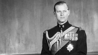 In this June 10, 1956 file photo, the Duke of Edinburgh poses for a photo as he observes his 35th birthday anniversary in Buckingham Palace, London