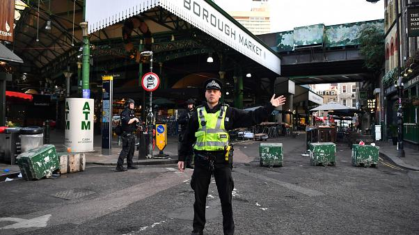 Police officers guard outside Borough Market after an incident at London Bridge