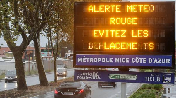 "A road sign reads ""Red alert, avoid your trips"" as the french Riviera is under a red alert for heavy rain and floods, in Nice, France, December 1, 2019."