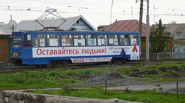 An HIV campaign logo on a tram in Russia