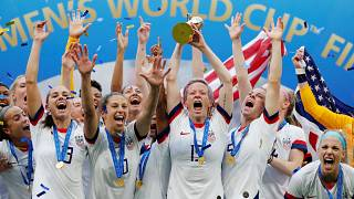 The US women's team, led by Rapinoe, celebrates winning the 2019 World Cup