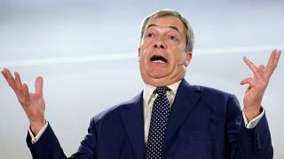 FILE PHOTO: Brexit Party leader Nigel Farage gestures as he speaks during a visit to Buckley, Britain December 2, 2019.