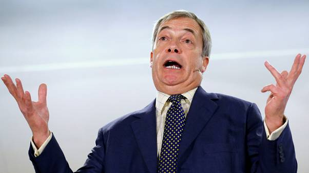 FILE PHOTO: Brexit Party leader Nigel Farage gestures as he speaks during a visit to Buckley, Britain December 2, 2019.