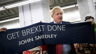 Boris Johnson posed with a knitted scarf given to him at his campaign event on Thursday