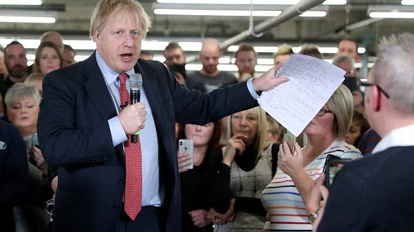 Britain's Prime Minister Boris Johnson delivers a speech during a meeting with workers as he visits John Smedley Mill in Matlock, Derbyshire, Britain December 5, 2019.