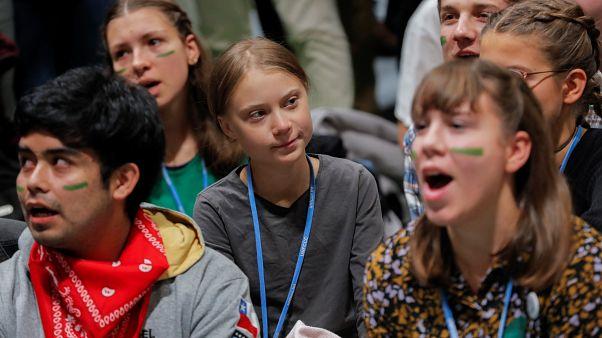 الناشطة السويدية الشابة غريتا تونبرغ انضمت إلى المحتجين في مدريد