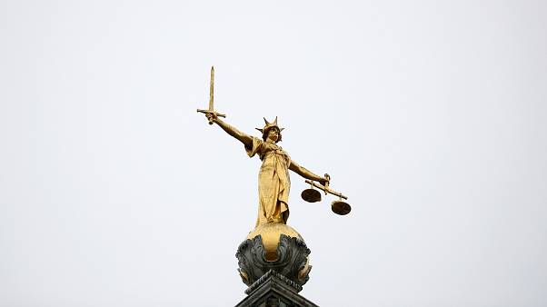 FILE PHOTO: Statue of Lady Justice is seen at Old Bailey central criminal court in London