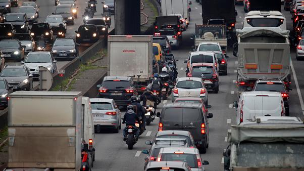 Rush hour traffic fills the ring road in Paris as a strike by French transportation workers continue to protest against French government's pensions reform plans.