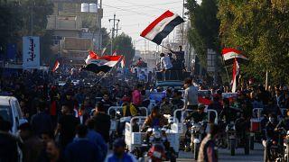 مقتل 12 متظاهراً على الأقل على يد مسلحين مجهولين وسط بغداد