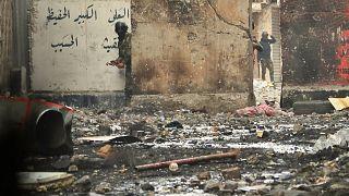 مردان مسلح نقابپوش دستکم ۲۳ معترض را در بغداد کشتند