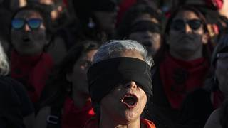"""Women perform """"A Rapist In Your Path,"""" in a demonstration against gender-based violence in Santiago, Chile"""