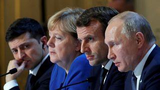 Ukraine's Volodymyr Zelenskiy (L), Germany's Angela Merkel, France's Emmanuel Macron, and Russia's Vladimir Putin in Paris on December 9, 2019.