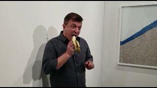 """Very tasty!"": Watch moment artist eats $120,000 banana at Art Basel"