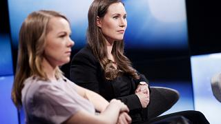 Finland's Members of Parliament, Katri Kulmuni (L) and Sanna Marin participate in the A-studio talk show in Helsinki, Finland December 3, 2019.