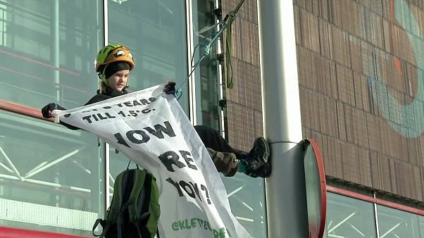 Eight-year-old scales street light to demand climate action at Madrid talks