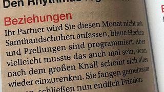 German publisher apologises for domestic violence horoscope 'error'