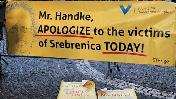A banner protesting against 2019 Nobel literature prize laureate Peter Handke is seen at the Stockholm Concert Hall, in Stockholm, Sweden, December 10, 2019.