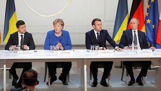 الرئيس الروسي فلاديمير بوتين والرئيس الفرنسي إيمانويل ماكرون والمستشارة الألمانية أنغيلا ميركل والرئيس الأوكراني فولوديمير زيلينسكي