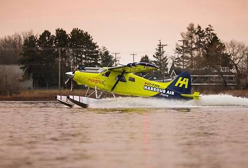 A Habour Air seaplane powered by an magniX all-electric propulsion system lands after a test flight on December 10, 2019.