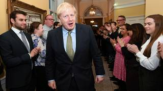 Britain's Prime Minister Boris Johnson is greeted by staff as he arrives back at Downing Street, in London, Britain December 13, 2019.