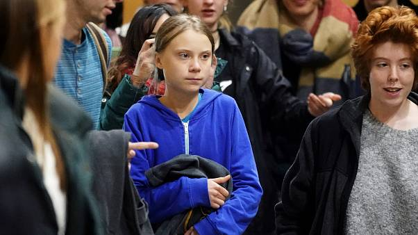 Climate change activist Greta Thunberg leaves after a meeting at Complutense University, as COP25 climate summit is held in Madrid, Spain, December 8, 2019.