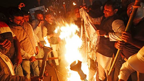 Members of the youth wing of India's main opposition Congress party burn a copy of Citizenship Amendment Bill