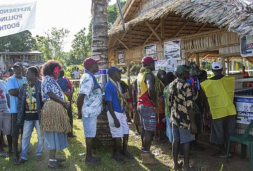 People queue to vote at a polling station in the capital Buka in an historical independence vote on November 25, 2019.
