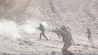 Çinli paramiliter grupların Doğu Türkistan'da tatbikat görüntüleri