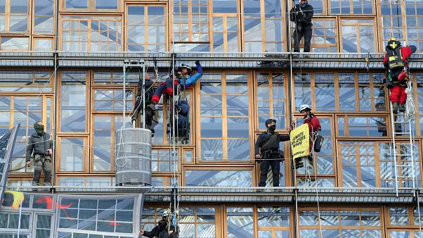 Police remove climate change activists from the EU Council headquarters, during a Greenpeace protest, ahead of an EU leaders summit in Brussels, Belgium December 12, 2019.