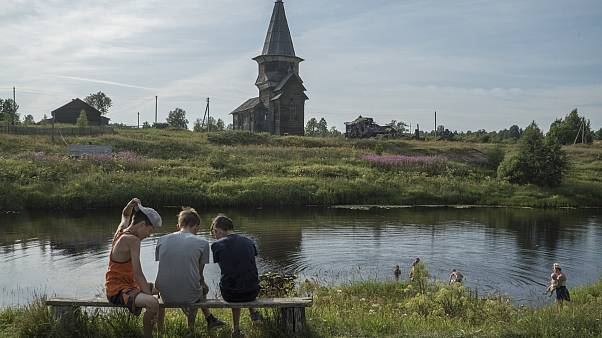 'We're the black restorers': Meet the volunteers saving the wooden churches in northern Russia