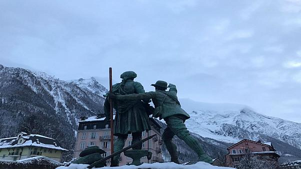 Chamonix, 12 December 2019 - Statue of Jaques Balmat showing Horace Benedict de Sassure the route up to the summit of Mont Blanc.