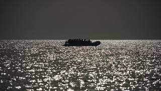 An overcrowded rubber boat is seen on the horizon in the Mediterranean Sea, 18 September, 2019. The Ocean Viking regularly conducts rescue missions on the Mediterranean,