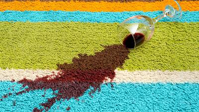 Red wine stains get on the carpet