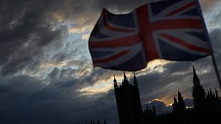 A Union Jack flag flutters in front of the Houses of Parliament in London, Britain, November 5, 2019.